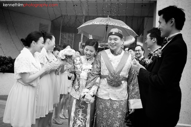 Hong Kong wedding morning bride and groom walk off from apartment laughing