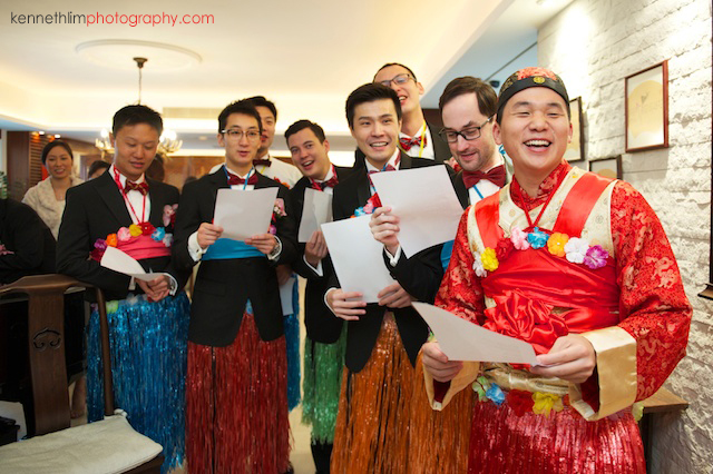 Hong Kong wedding morning groom and groomsmen playing games singing laughing