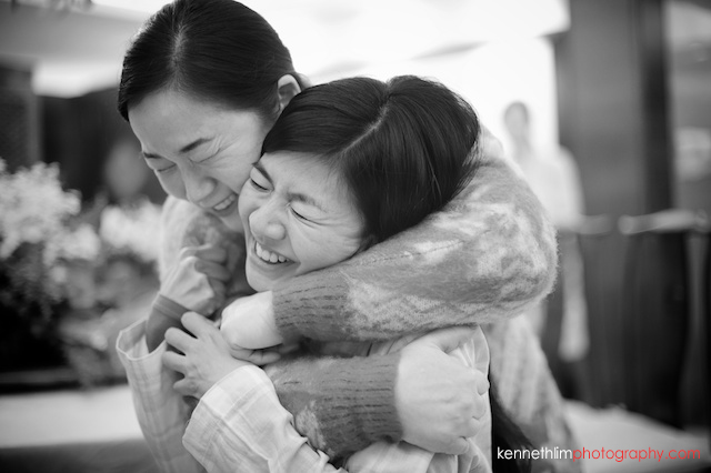 Hong Kong wedding morning preparations bride getting hair done hugging relative
