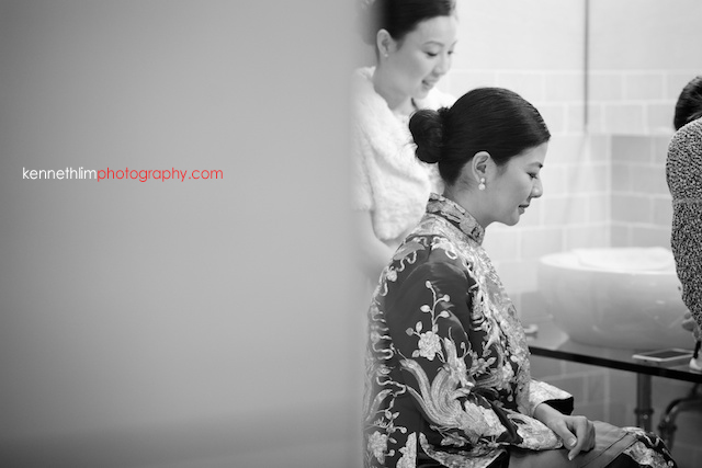 Hong Kong wedding morning preparations bride getting hair done in wedding outfit