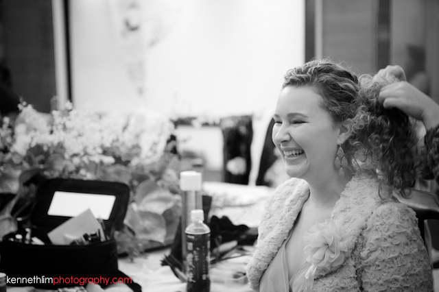 Hong Kong wedding morning preparations bridesmaid getting hair done and laughing