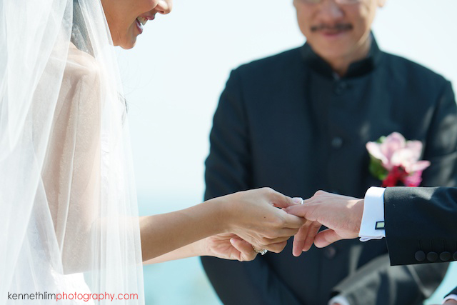 Hong Kong wedding Shek O Golf and Country Club ceremony bride putting ring on groom