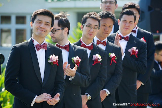 Hong Kong wedding Shek O Golf and Country Club ceremony groomsmen smiling and clapping hands