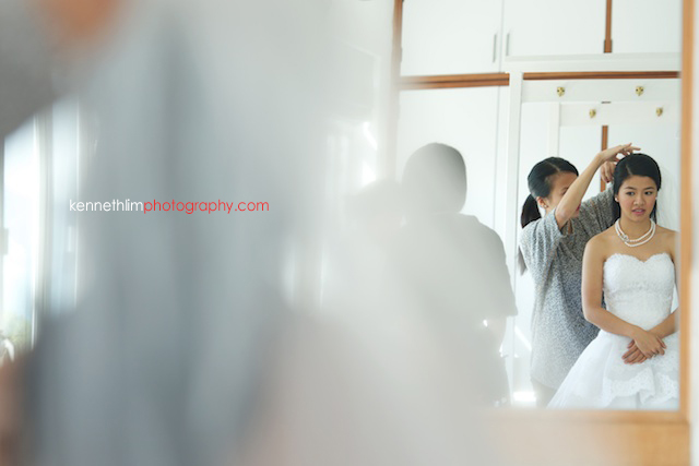 Hong Kong wedding Shek O Golf and Country Club morning bride putting on wedding gown reflection