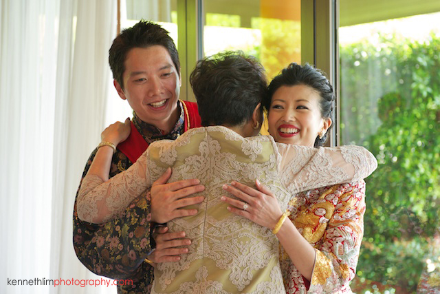 Koh Samui wedding Shasa Resort bride and groom hugging mother of groom