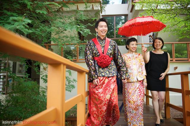 Koh Samui wedding Shasa Resort bride and groom walkoff under red umbrella
