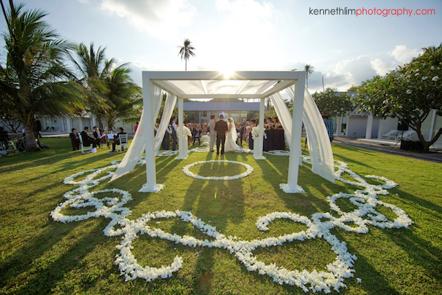 Koh Samui wedding YL Residence bride and groom at the altar during sunset