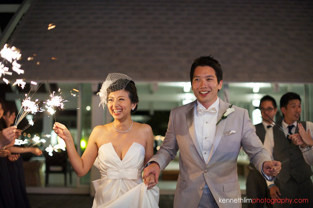 Koh Samui wedding YL Residence bride and groom laughing and smiling with sparklers in hand