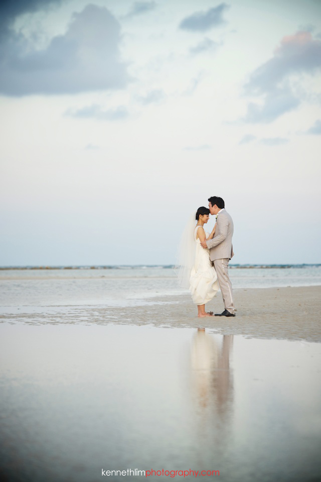 Koh Samui wedding YL Residence bride and groom outdoor portrait session kissing on the beach