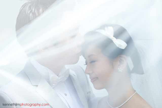 Koh Samui wedding YL Residence bride and groom outdoor portrait session kissing under brides wedding veil