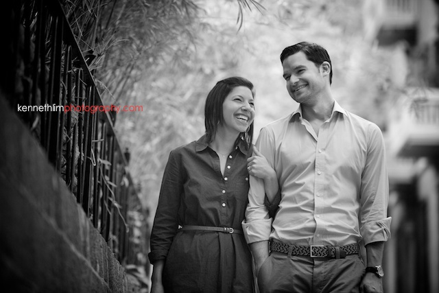 Hong Kong engagement photoshoot outdoors couple walking with arms locked black and white