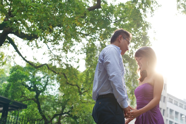 Hong-Kong-Park-engagement-photoshoot-couple-holding-hands-sun-in-back