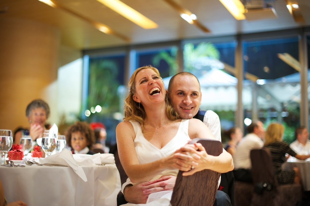 Hong Kong Novotel wedding photography banquet bride and groom listening to speeches laughing together