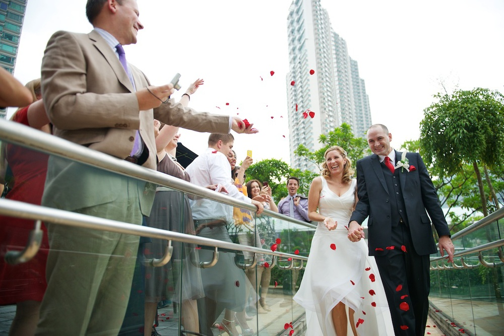 Hong Kong Novotel wedding photography ceremony bride and groom marching in laughing together