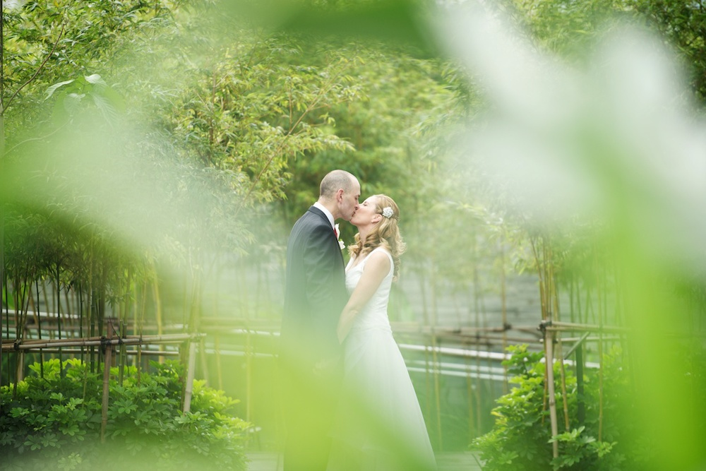Hong Kong Novotel wedding photography portraits bride and groom kissing each other