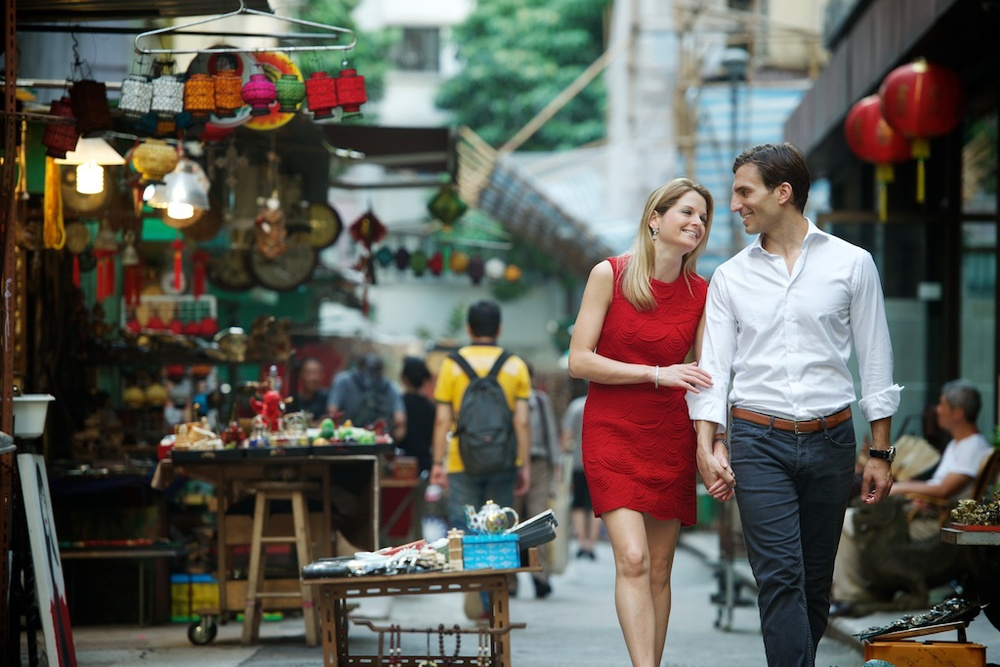 Hong Kong Soho engagement photography couple photoshoot walking holding hands laughing together