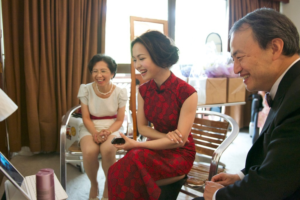 Hong Kong Beas River Country Club wedding photography bride watching groom playing games laughing with parents
