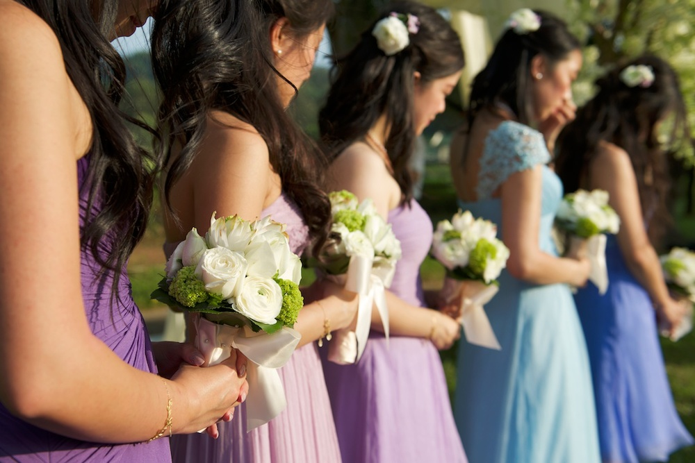 Hong Kong Beas River Country Club wedding photography bridesmaid with flowers in hand praying