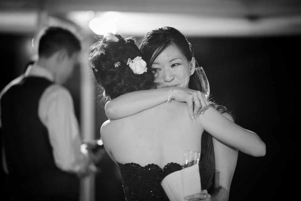 Hong Kong Beas River Country Club wedding photography maid of honor and bride hugging after speech