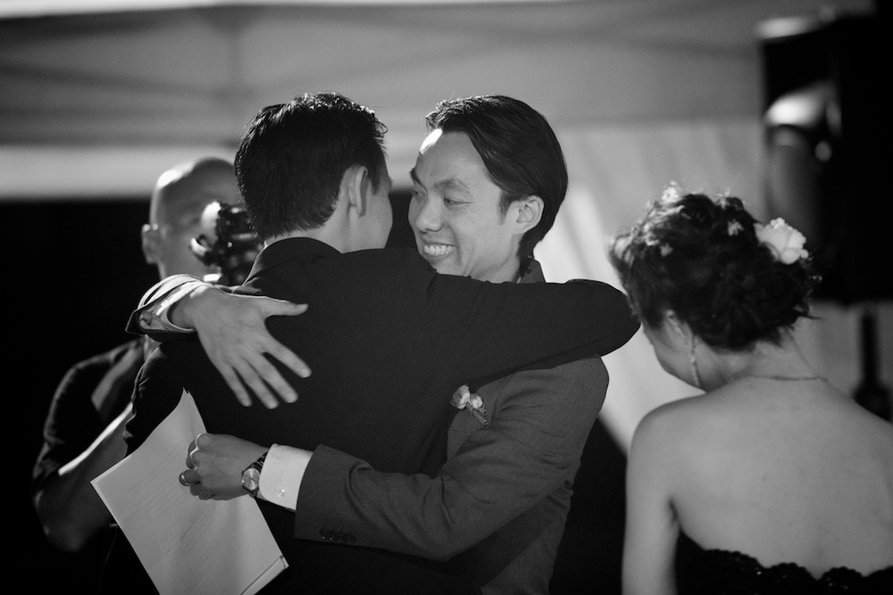 Hong Kong Beas River Country Club wedding photography groom and best man hug after speech
