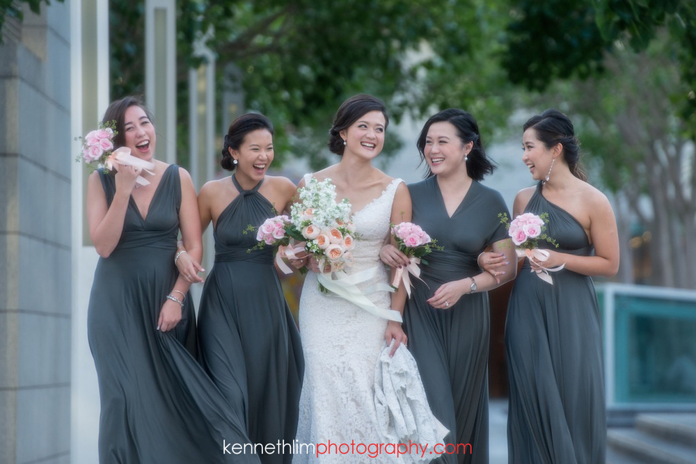 Hong Kong- wedding photography IFC Cuisine Cuisine Central wedding portraits bride and bridesmaids laughing together