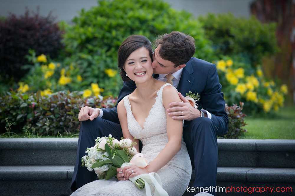 Hong Kong wedding photography IFC Cuisine Cuisine Central wedding portraits bride and groom sitting kissing and laughing together