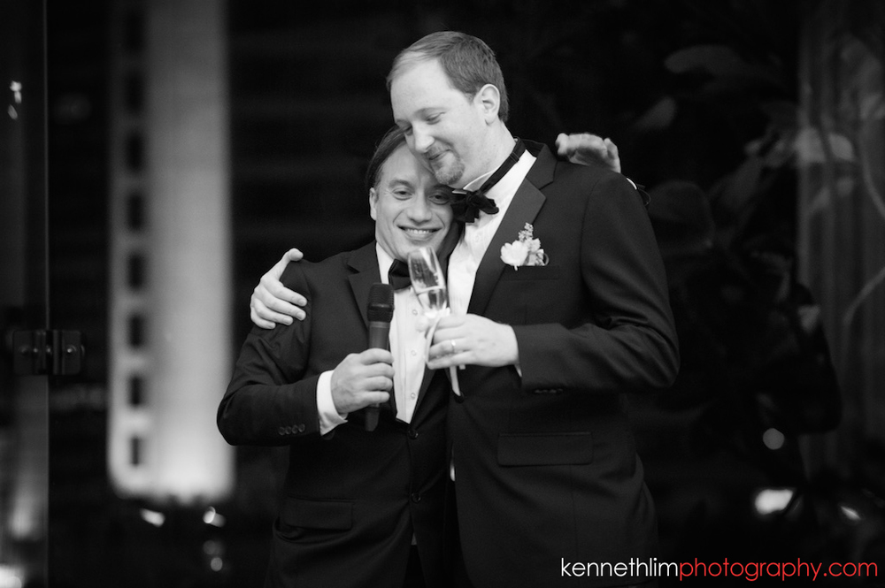 Hong Kong Club wedding day photography big day evening banquet groom and best man hugging after speeches