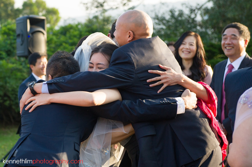 Hong Kong Wedding photography one thirty one after ceremony bride hugging family