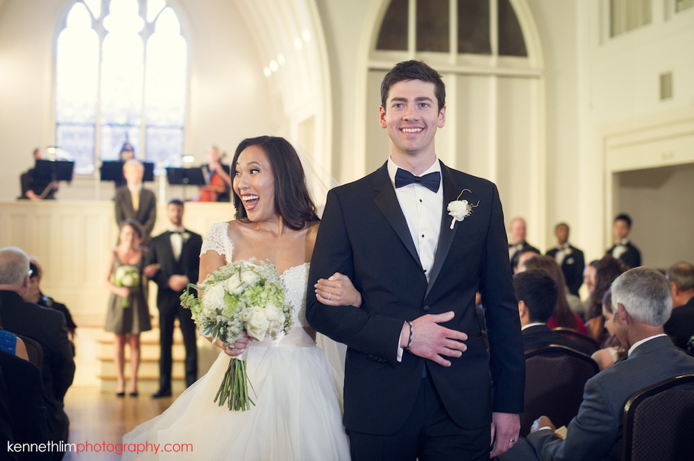 Atlanta wedding Kairos Church big day photography bride and groom march out happily