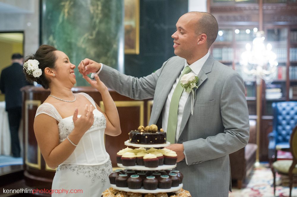 Hong Kong Island Shangri-la Atrium Library wedding day photography groom feeding bride cake after cake cutting ceremony
