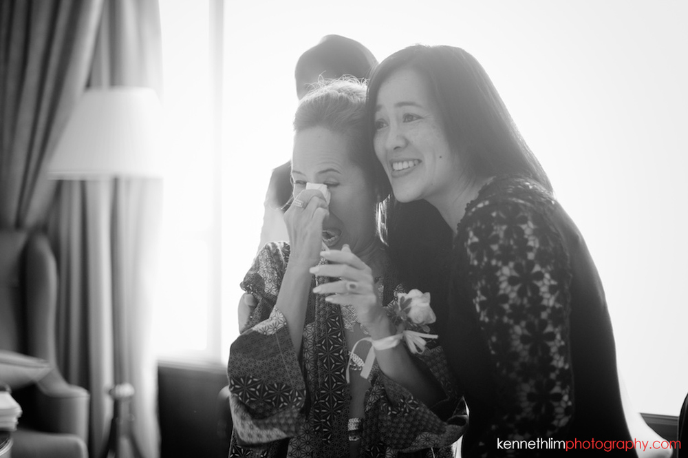 Hong Kong Island Shangri-la Atrium Library wedding day photography mother of bride tears of joy looking at bride