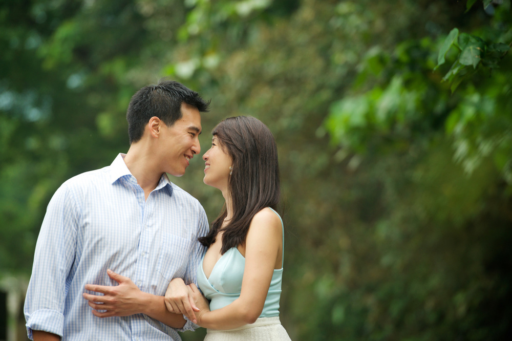 hong-kong-pre-wedding-engagement-photographer-couple-smiling-together-nature-walk.jpg
