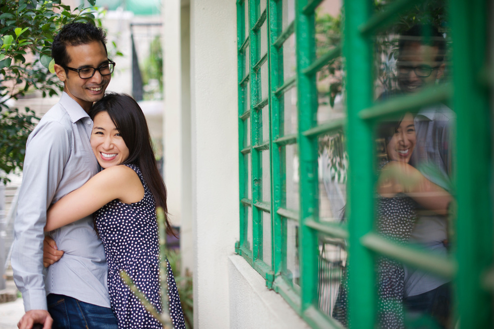 hong-kong-pre-wedding-engagement-photographer-couple-hugging-together-laughing-hong-kong-botanical-gardens.jpg