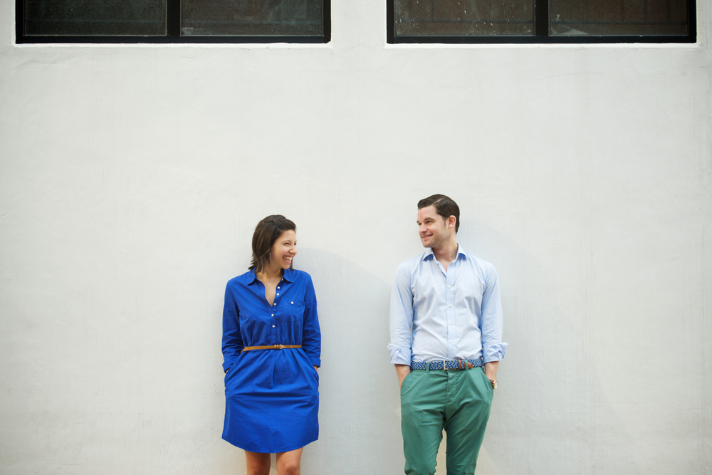 hong-kong-pre-wedding-engagement-photographer-couple-laughing-together-white-wall-soho.jpg