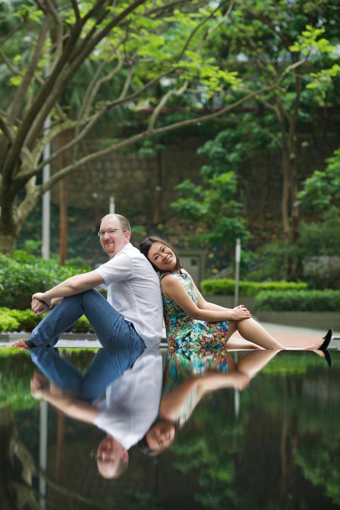 hong-kong-pre-wedding-engagement-photographer-couple-sitting-with-water-reflection-hong-kong-park.jpg