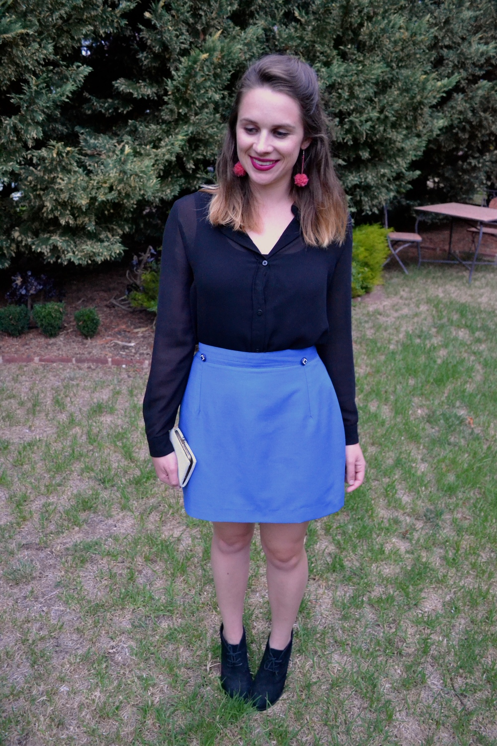 blue-mini-skirt-black-blouse-pom-pom-earrings