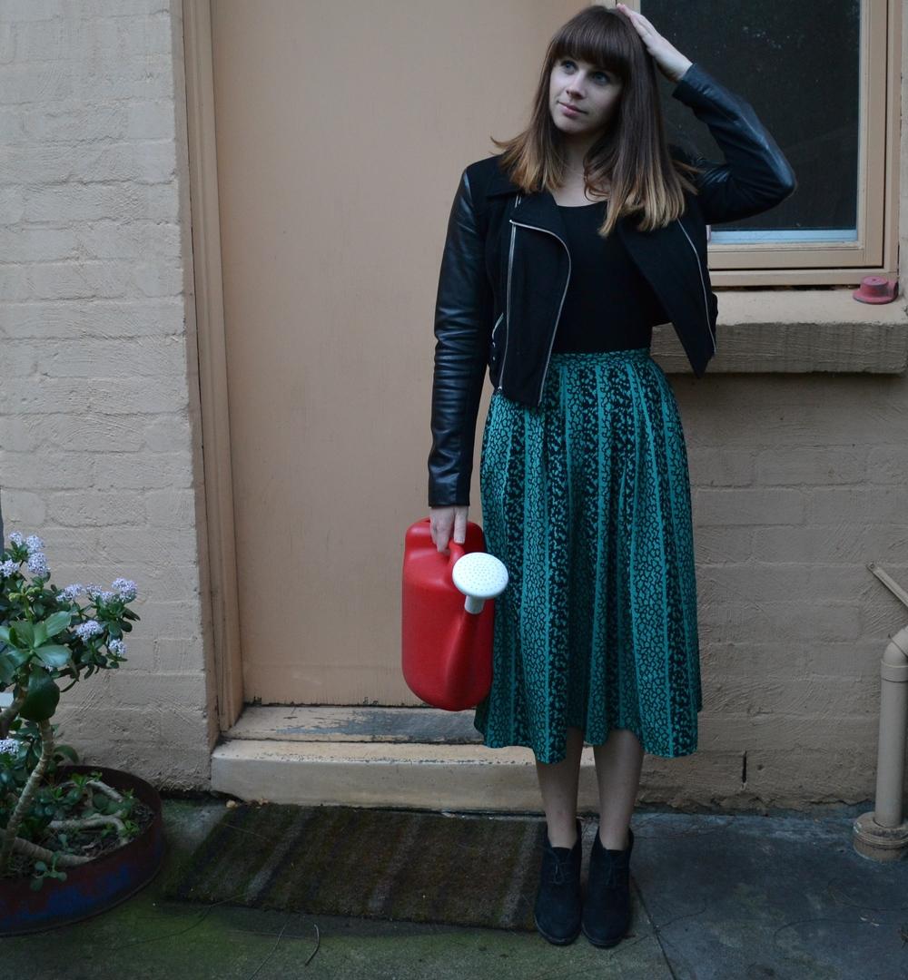 green-midi-skirt-black-leather-jacket