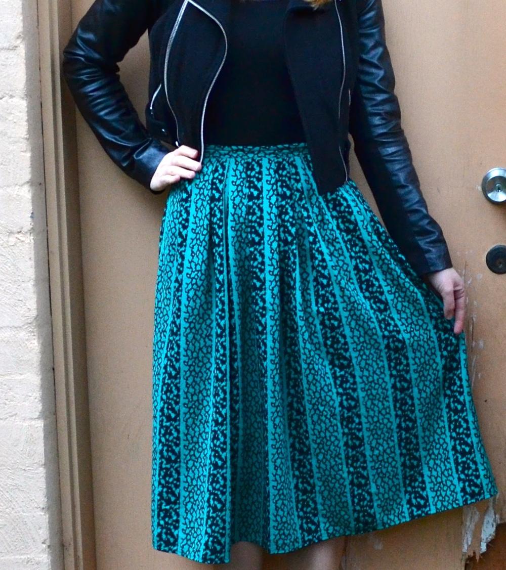 green-midi-skirt-leather-jacket