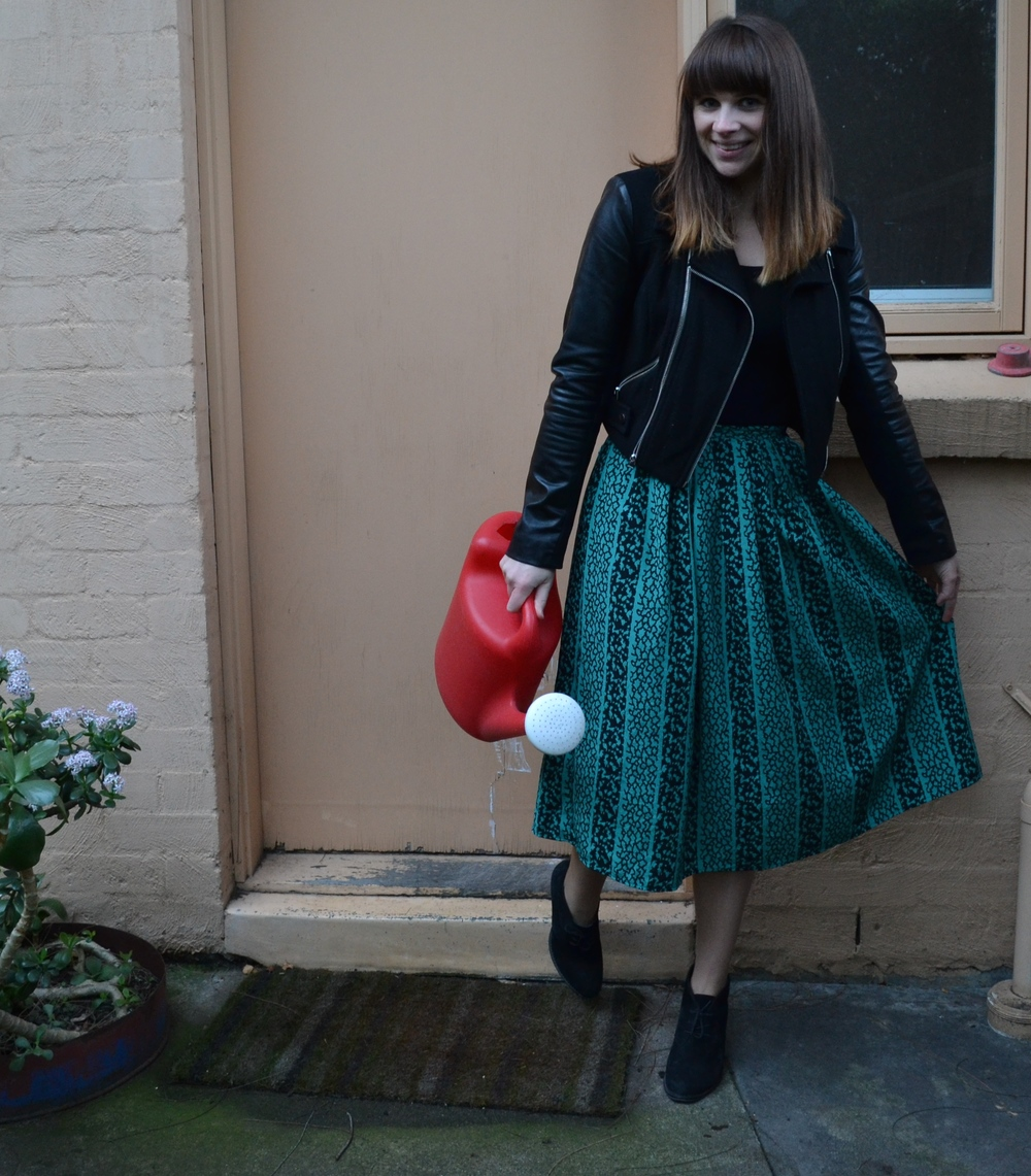 black-leather-jacket-green-midi-skirt