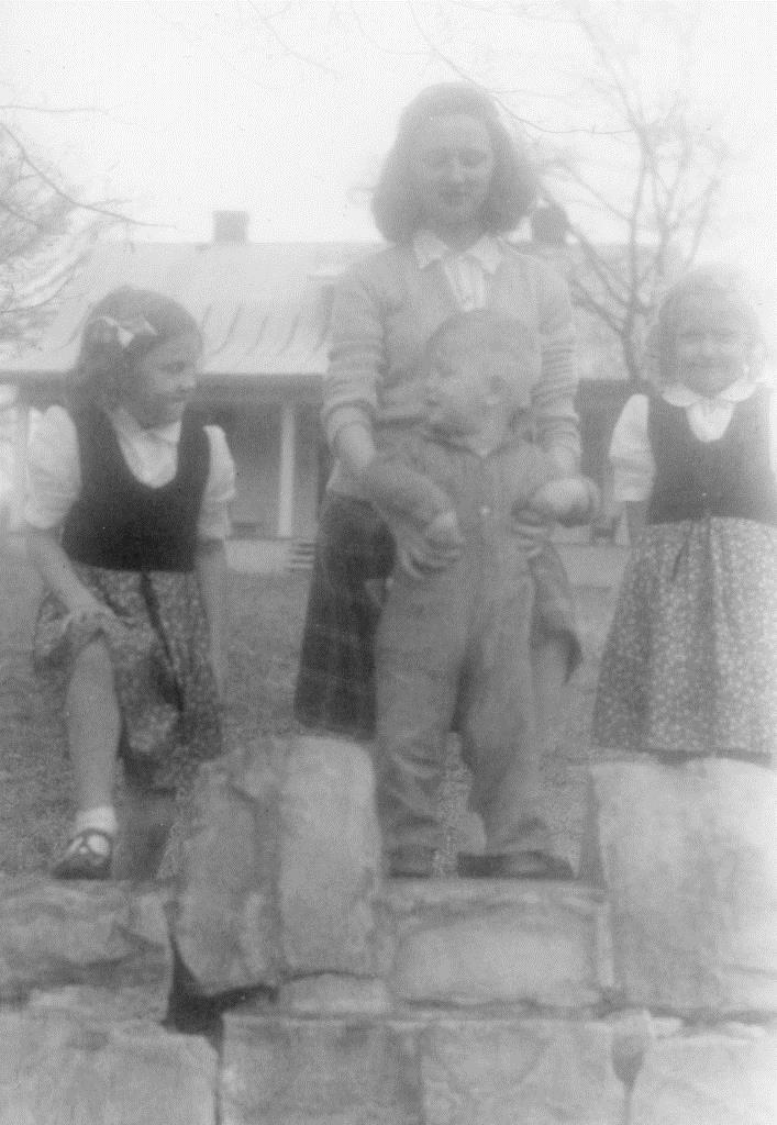 Lucy, George and Georgianna in front of Whooping Crane Farm, 1942