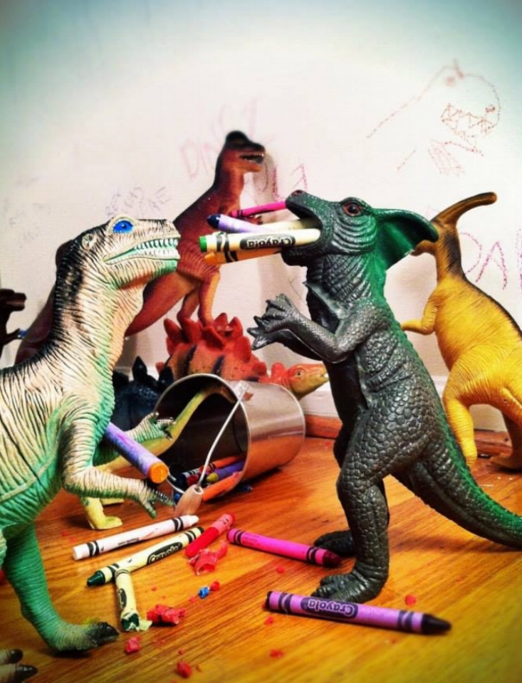 """Don't let Mom and Dad see this—the dinosAURS drew on the wall!"""