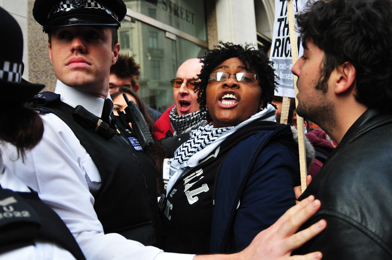 Protesters and police clash in front of a Starbucks Coffee shop in Vigo Street, London.