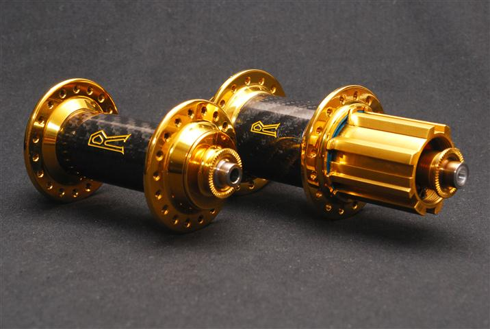 """Royce """"Venus"""" hubs with a titanium nitride finish and lacquered carbon fibre sleeve."""