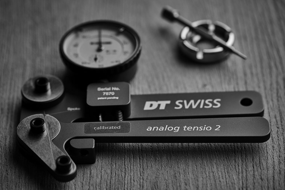 A DT Swiss Tensio 2.  One of a few spoke tension meters that I employ to measure spoke tension and to evaluate the overall evenness of a wheels final tension.