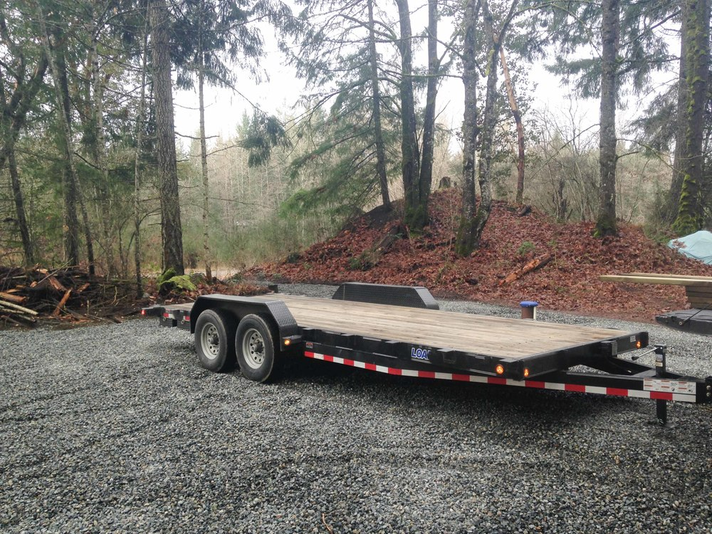This is the custom 8×20 trailer that we purchased, right after we towed it back to the job site. Now the work starts!