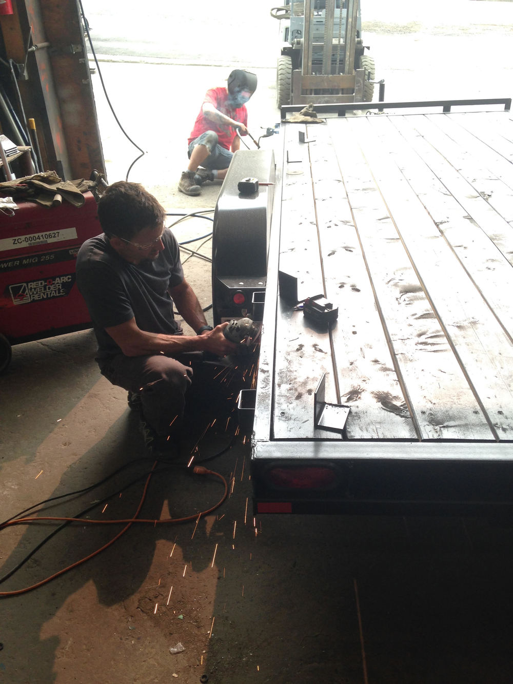 Our lead builder Brad putting some finishing touches on the trailer.
