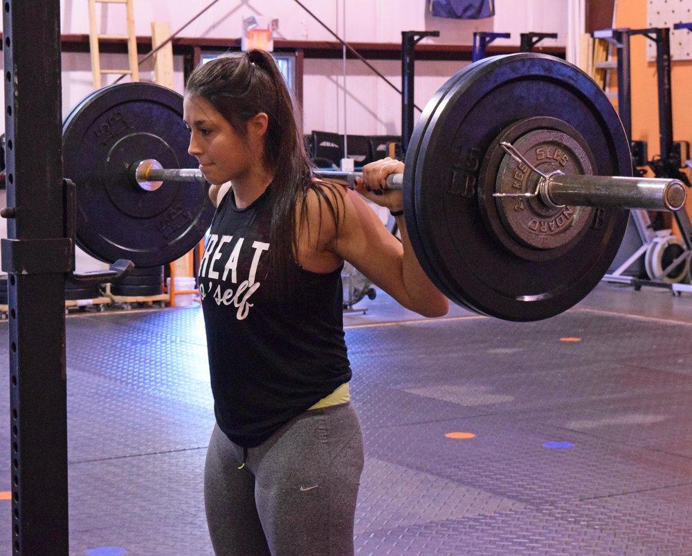 Jordan enjoying some pain-free squatting at Momentum Fitness.
