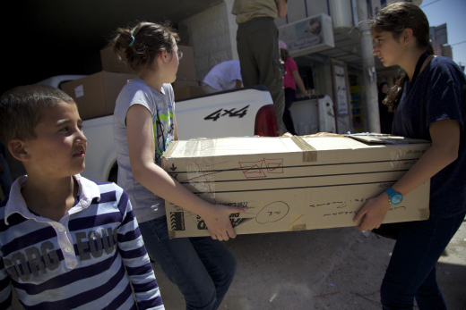 Children unloading the trucks in Mafraq.