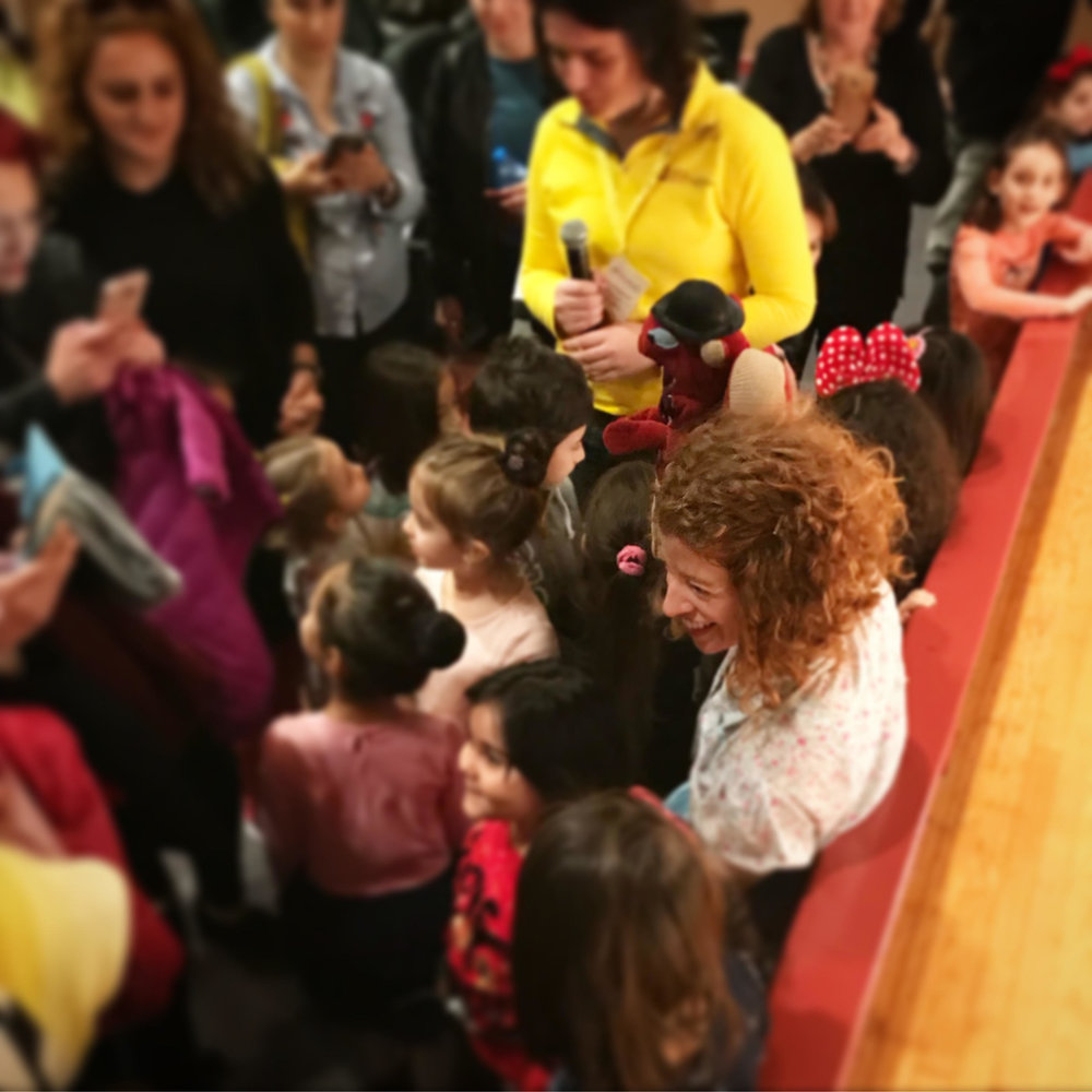 Bonnie and Squirrel being mobbed by fans after a performance.