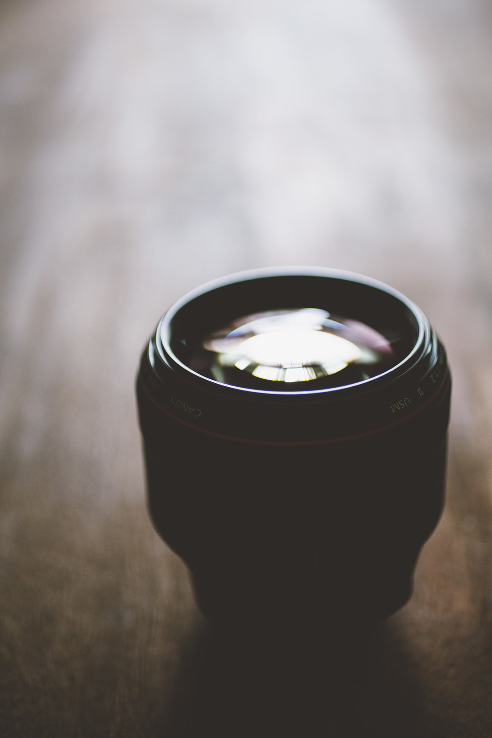 Canon 85mm f/1.2L II USM– What else can i say about this mid-range prime other than wow. This is once amazingly beautiful piece of glass and you get some of the most striking bokeh that i have seen. The only caveat to this lens is it's strange and rather slow motorized autofocus. Therefore it's not a great lens for when your subject is in motion but for static models it's perfect and that's why this lens remains a staple in my bag.